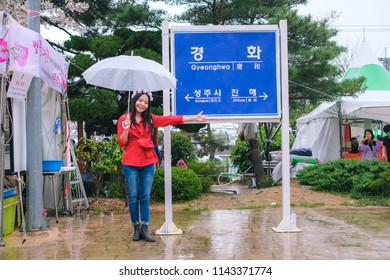 Jinhae, South Korea - April 2018 : Young pretty girl traveling in Jinhae cherry blossom festival at Jinhae city of South Korea on April 2018.