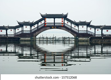 JINXI, SHANGHAI, CHINA � JANUARY 9: the antique Wenchang Pavilion to the old village at dusk. The village is a Shanghai tourist attraction with 100000 visitors per year. January 9, 2010, Jinxi, China