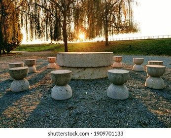 Târgu Jiu, RO -November 25, 2020: Table of Silence (Masa Tacerii) from the Sculptural Ensemble of Constantin Brancusi. 12 Hourglass shaped chairs representing the passing of time. Amazing sunset view.