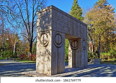 Târgu Jiu, Romania - November 22, 2020: Gate of the Kiss and Alley of Chairs by Constantin Brancusi. Sculptural ensemble situated in the city central park. UNESCO world heritage site.Autumn side view