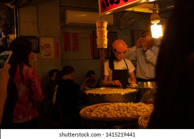 Jiufen New Taipei City/ Taiwan - April 20 2019: Woman preparing Fishball at Jiufen Old Street, New Taipei City, Taiwan