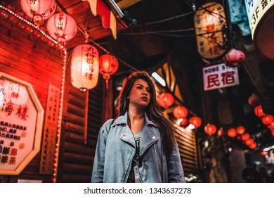 Jiufen, Taiwan - 3/7/19 - A woman walks Old Street of Jiufen