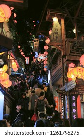JIUFEN, TAIWAN - December 18: Tourist enjoy walking at night in the narrow alleys of the small mountain town of Jiufen on December 18, 2018 in Jiufen