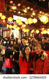 JIUFEN, TAIWAN - December  21: Tourist enjoy taking photos at night in the narrow alleys of the small mountain town of Jiufen on December 21,2018 in Jiufen