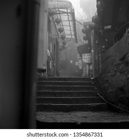 JIUFEN, TAIWAN - FEBRUARY 22, 2019: The shops in Jiufen Old Street early in the morning during the rain Taiwanese village of Jiufen shot with black and white film photography