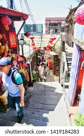 JIUFEN, TAIWAN - JUL 14, 2014: Visitors mingle at historic Jiufen Old Street, a bustling mountain town famous for its quaint narrow streets, teahouses, food stalls & sweeping views of the mountains.