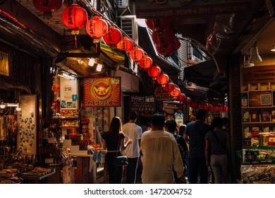 Jiufen, Taiwan - November 07, 2018: A young woman walks in the crowd at the Old Street market on November 7, 2018, in Jiufen, Taiwan