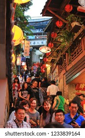 JIUFEN, TAIWAN - November 18: Tourist enjoy taking photos at night in the narrow alleys of the small mountain town of Jiufen on November 18, 2018 in Jiufen