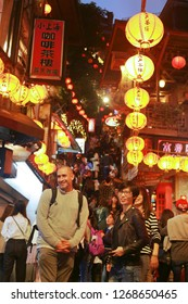 JIUFEN, TAIWAN - November 18: Tourist enjoy taking photos at night in the narrow alleys of the small mountain town of Jiufen on December 20, 2018 in Jiufen