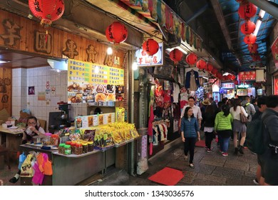 JIUFEN, TAIWAN - NOVEMBER 23, 2018: People visit heritage Old Street market of Jiufen located in Ruifang District of New Taipei City. Jiufen is also known as Jioufen or Chiufen.