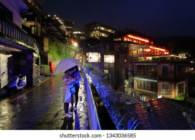 JIUFEN, TAIWAN - NOVEMBER 23, 2018: People visit rainy heritage Old Town of Jiufen located in Ruifang District of New Taipei City. Jiufen is also known as Jioufen or Chiufen.