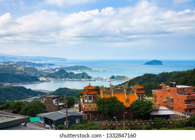 Jiufen, Taiwan -  November 7, 2018: Magnificent views of the old Chinese temple and the ocean coast from the Jiufen village on November 7, 2018, in Jiufen, Taiwan