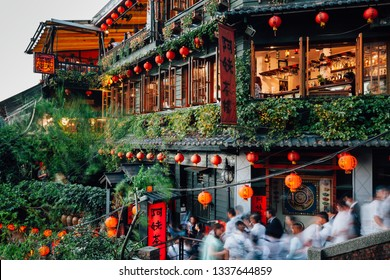 Jiufen, Taiwan - November 7, 2018: Tourists walk through the famous stair in front of the old teahouse decorated with Chinese lanterns, Jiufen Old Street, Taiwan on November 07 2018.