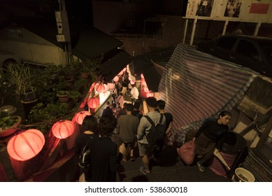 Jiufen,Taiwan - December 18 ,2016 : Tourists from all over the world walking and shopping in famous street night market in Jiufen. Jiufen is a mountain area in the Ruifang District of New Taipei City