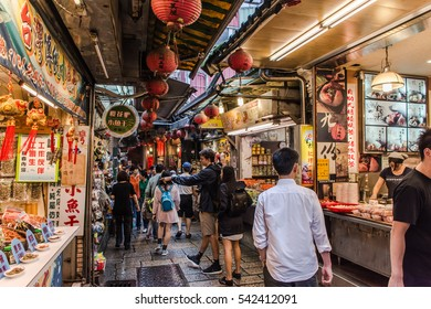 JIUFEN,TAIWAN - OCT 22: Local and tourist are walking and shopping in Jiufen old street,Ruifang district,Taiwan on October 22,2015.This place is very attracts many thousand of people a day.