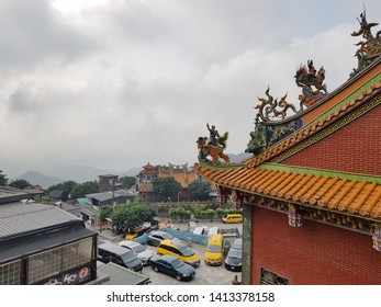 Jiufen,Taiwan-Circa March 2019:From top view in cloudy day morning,cars park around front area of local temple in Jiufen that is popular travel destination in Taiwan,well known for teahouse on hill.