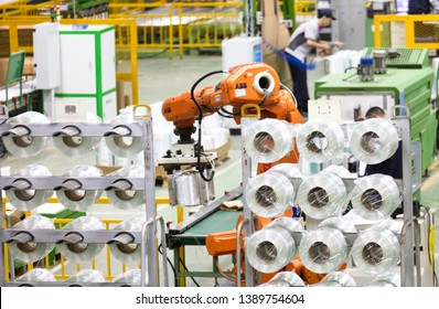 Jiujiang, China - April 19, 2019: ABB intelligent robots are producing glass fibers for export to the United States in a workshop of a modern company in eastern China. Sino-US trade frictions.