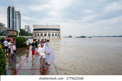 Jiujiang, China - July 11, 2020: Jiujiang Station on The Yangtze River, China's largest river, has exceeded the warning level. Citizens came to view the scenery. Government officials were on duty.