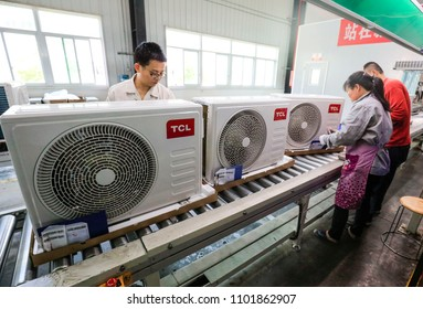 JIUJIANG CHINA-April 19, 2018: technical workers assemble air conditioners in the TCL production base of Jiujiang,Jiangxi, Eastern China. TCL group is a global intelligent product manufacturing group.