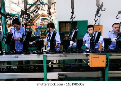 JIUJIANG CHINA-April 19, 2018:Taiwan Rui Zhi Group invested in the electromechanical plant in Jiujiang, Eastern China, where workers operated intelligent robots to produce air-conditioning compressor