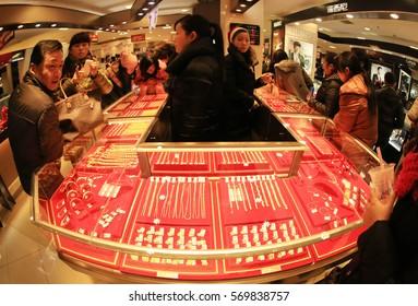 JIUJIANG CHINA-December 24, 2012: Chinese Eastern inland city of Jiangxi Jiujiang, Christmas Eve merchant discount promotions, consumers come to the shopping mall launching a panic buying frenzy.