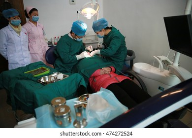 Jiujiang China-January 9, 2013?Chinese hospital, dental doctors are doing dental implant surgery. The growth of China's dental implants market, to attract the oral institutions to occupy the market.