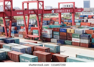 JIUJIANG CHINA-June 19, 2018: busy Jiujiang port of the Shanghai Port Group, the cargo yard is packed full of containers waiting for transportation. The freight car is traveling on the Yangtze River.