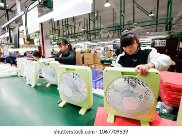 JIUJIANG CHINA-Mar30, 2018: in Jiangxi province of eastern China, workers in the electric fan assembly line of AIRMATE  Co., Ltd., the company's exports of electrical products to the United States.