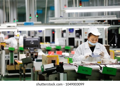 JIUJIANG CHINA-March 16, 2018:The export processing zone in the eastern city of Jiujiang, Jiangxi SONIRD Polytron Technologies Inc automation workshop, workers are making photovoltaic power