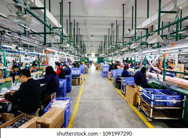 JIUJIANG CHINA-March 17, 2018: workers on the production line of electrical appliances company, Jiujiang, Eastern China. Workers can't relax for a minute, like robots in Chaplin's movie modern times.