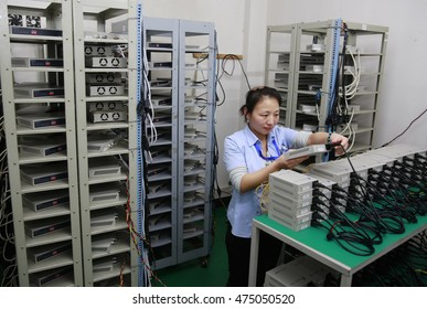 Jiujiang, China-MAY 13, 2014:A high - tech manufacturing enterprise for producing electronic chip. Workers are putting electronic components into circuit boards.