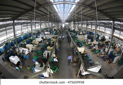 Jiujiang, China-MAY28, 2014:China Original Equipment Manufacturer  bathroom products, the workers are shaping the brass. exports to Europe and the United States, Australia, Japan and Southeast Asia.