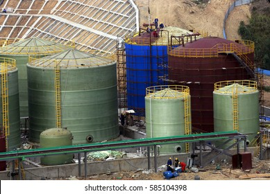 JIUJIANG CHINA-Oct 9 2013:Jiangxi Datang Chemical Co., Ltd. workers are installing pipelines.by Daikin Industrial Corporation and Zhejiang certralfluor Industrial Group, a joint venture company.