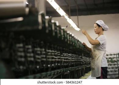 JIUJIANG CHINA-Oct9, 2013:Jiangxi,female workers in Jin Yuan chemical fiber products Co., Ltd. factory workshop. Chemical fiber products will be exported to Europe, America and Southeast asia.