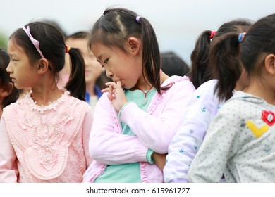 JIUJIANG CHINA-September 19, 2014, China's public elementary school students play in the spacious playground, enjoy carefree childhood. Jiujiang, a small city in East China's Jiangxi province.
