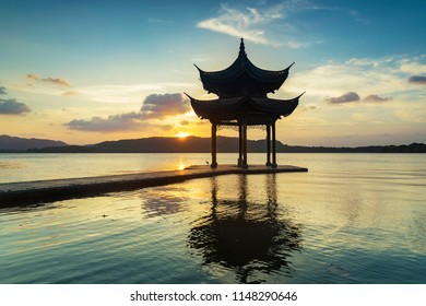 """Jixian pavilion in hangzhou during sunset.the chinese word in photo means""""Jixian pavilion"""".chinese ancient pavilion on the west lake in hangzhou.West Lake   of the most famous scenic spots in China."""