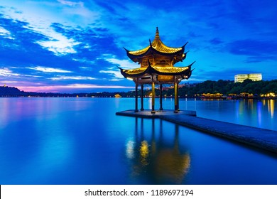 "Jixian pavilion in hangzhou during sunset.the chinese word in photo means""Jixian pavilion"".chinese ancient pavilion on the west lake in hangzhou.West Lake   of the most famous scenic spots in China."