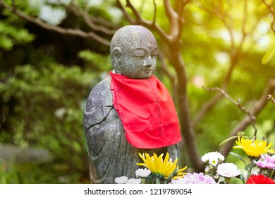 Jizo Bodhisattva (Japanese Buddhist Monk) Statue in Hase-dera, Kamakura, Japan with Sunlight.