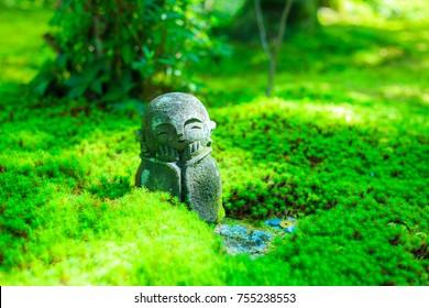 Jizo and green garden