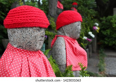 """Jizo"", Ksitigarbha with red knit cap and baby bib"
