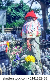 Jizo monk statue with bib and hat - Japan. Jizo is a guardian of aborted children and kids who die prematurely