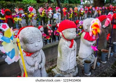 Jizo statues at Zojo-ji temple cemetery, Tokyo, Japan