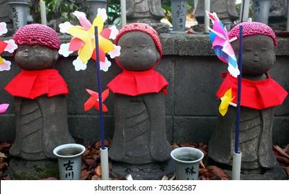 Jizo statues at Zozoji temple in Tokyo, Japan