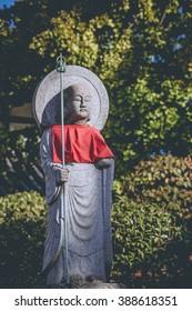 Jizo, Jizo or stone statue in many form wearing red apron in the Okunoin temple, Koyasan, Japan
