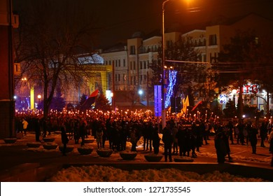 JJanuary 1, 2019, the Dnieper, UKRAINE - a torchlight procession in the city center in honor of the 110th anniversary of the birth of Stepan Bandera, a politician in Ukraine.