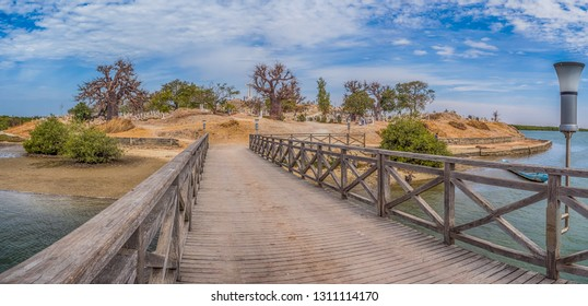 Joal-Fadiout, Senegal - January, 26, 2019: Panoramic view of Mixed Muslim-Christian Cemetery. Joal-Fadiouth town and commune in the Thiès Region at the end of the Petite Côte of Senegal. Africa.