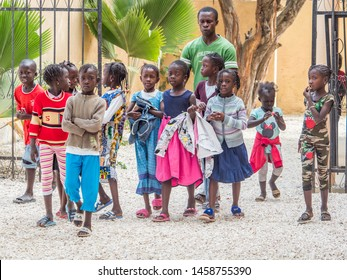 Joal-Fadiout, Senegal - January, 26, 2019: Black chidren on the street of seashell island -  Joal-Fadiouth town.  Commune in the Thiès Region at the end of the Petite Côte of Senegal. Africa.