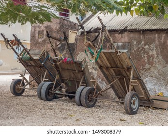 Joal-Fadiouth, Senegal - January 24, 2019: A few carts are standing next to the building on the island. Town and commune is in the Thiès Region at the end of the Petite Côte of Senegal. Africa.