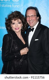 Joan Collins and Percy Gibson at the 2011 Unicef Ball, Beverly Wilshire Hotel, Beverly Hills, CA 12-08-11