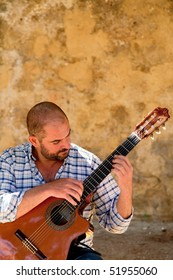 Joao Manuel Bastos Accomplished classical guitarist. Playing in the castle grounds above Lisbon.